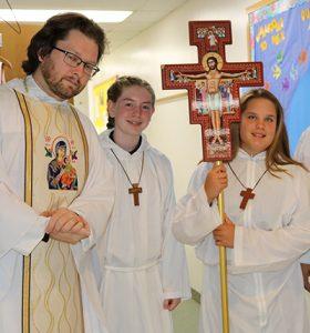 Priest with altar girls