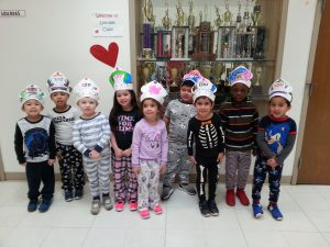 kids standing with 100 days crown on their heads